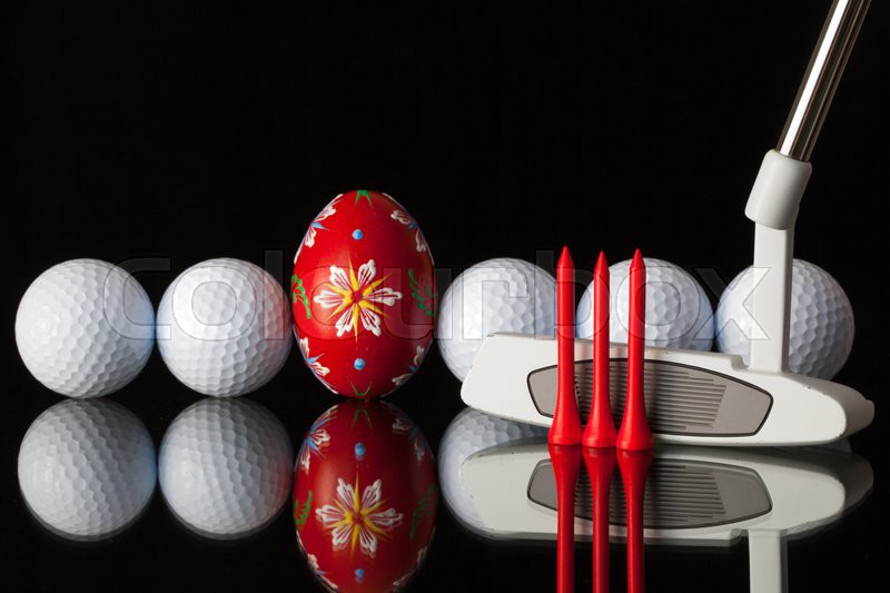 Golf equipments and egg on a black glass desk, stock photo