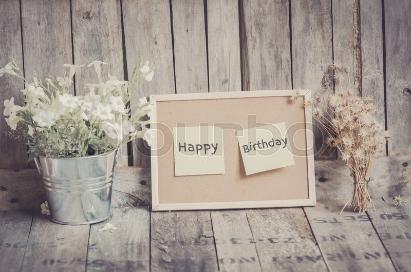 vintage style effect happy birthday message on corkboard with