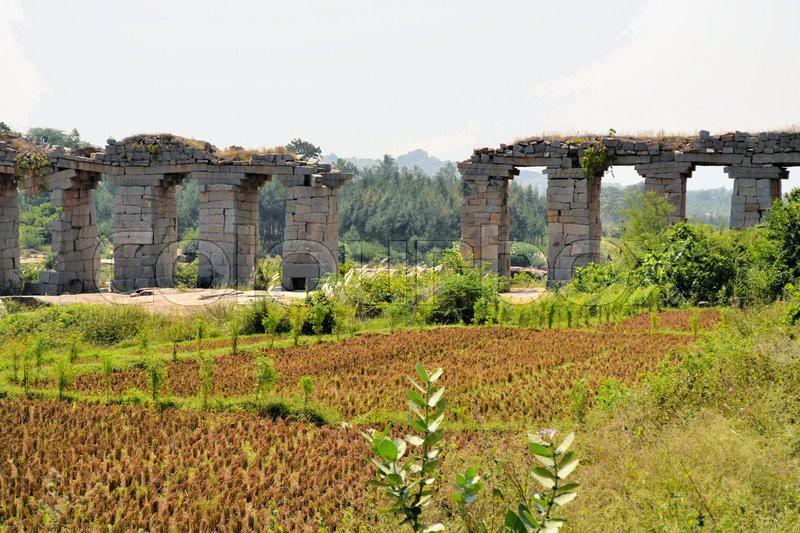 Ancient aqueduct of Vijayanagara Hindu civilization in Hampi, Karnataka, Southern India, stock photo