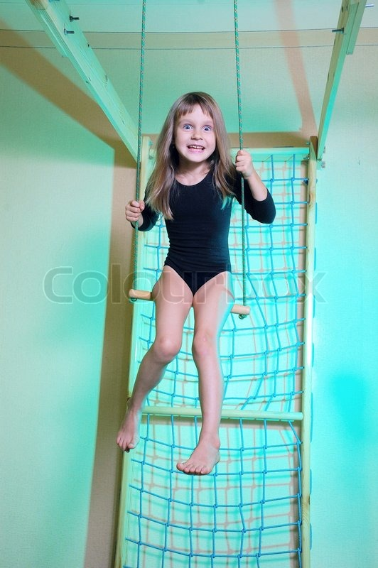 Little 5 Year Old Girl Wearing A Black Leotard Playing