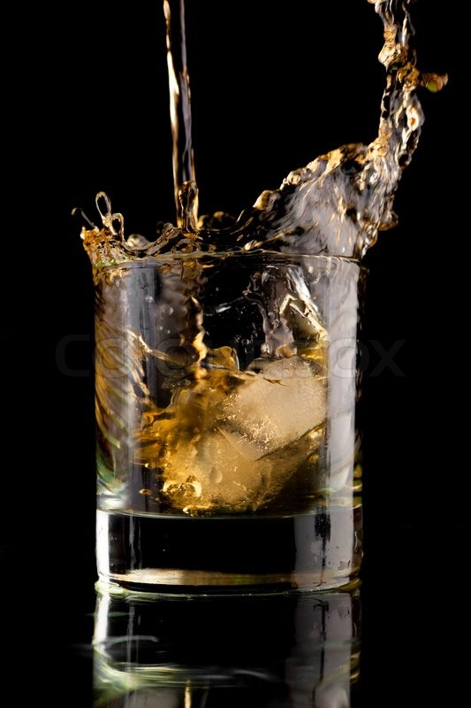 Quot Splash In A Glass Of Whiskey With Ice On A Black