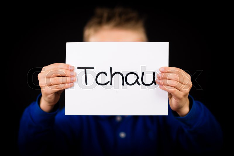 Studio shot of child holding a sign with Portuguese word Tchau - See You Later, stock photo