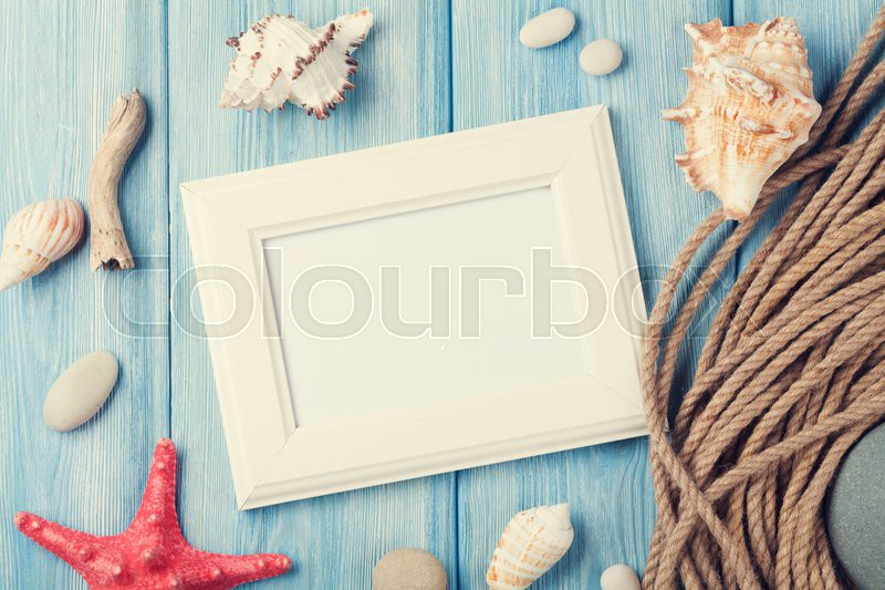 Summer time sea vacation with blank photo frame, star fish and marine rope. Retro toned, stock photo