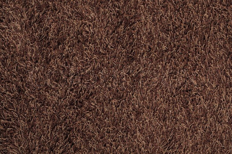 New Brown Fluffy Rug Background Texture Stock Photo