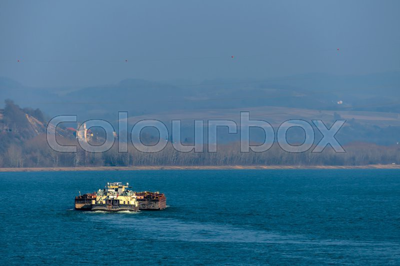 With bulk freighters traveling symbol for shipping, freight, logistics, export, navigation, stock photo