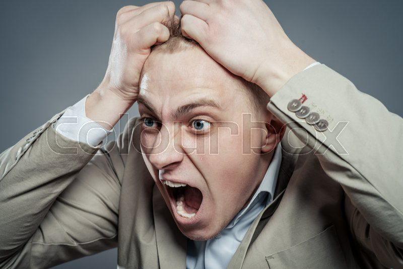 Closeup portrait of angry, frustrated man. Negative human emotions and facial expressions, stock photo