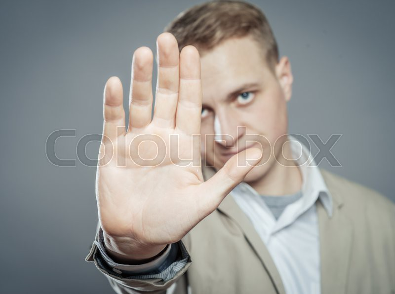 Business man holding out hand stop | Stock Photo | Colourbox