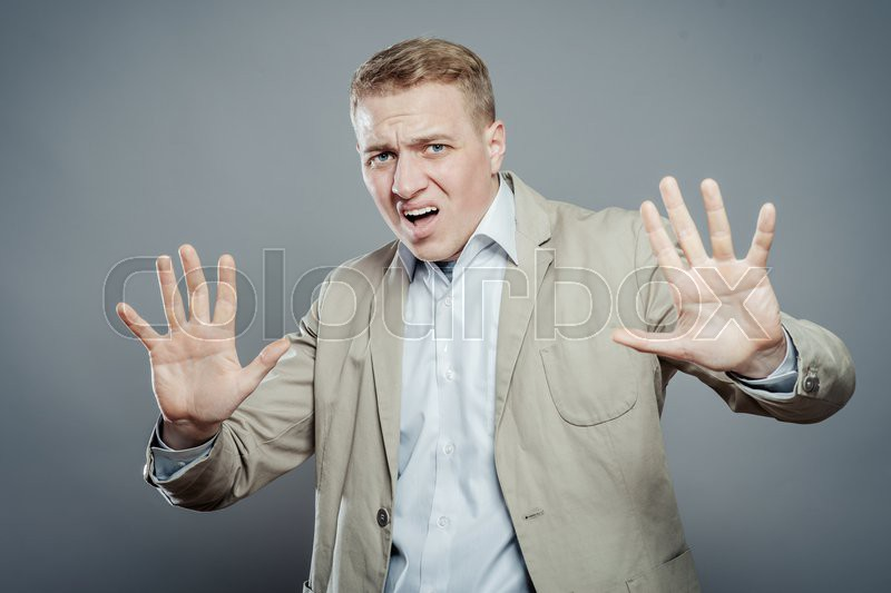 Technology Management Image: Business Man Holding Out Hands Stop