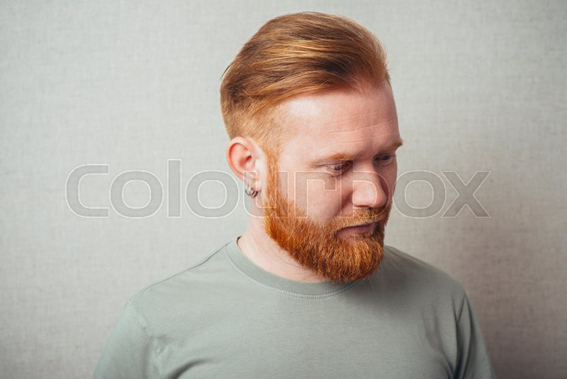 portrait of a Young red bearded Man feel bad, sad, stock photo
