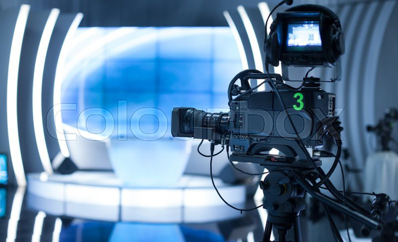 Video camera - recording show in TV studio - focus on camera, stock photo