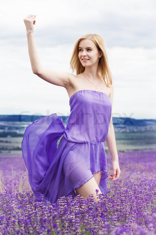 Beautiful Blonde Girl Is Wearing Purple Dress Relaxing In