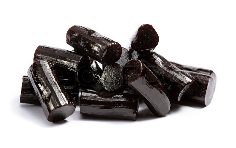 Stock image of 'Pieces of black liquorice on white'
