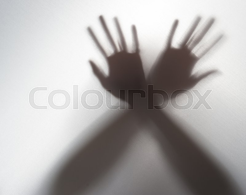 Silhouette of a hand in the back light,blur image, stock photo