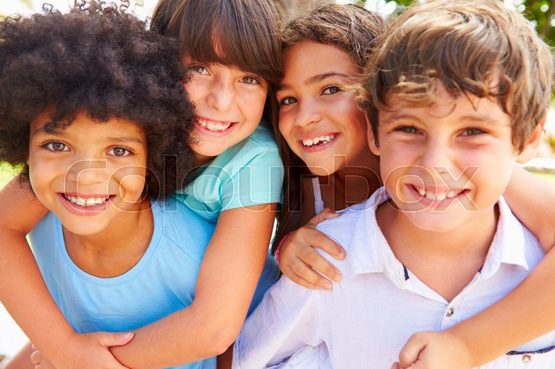 Group Of Children Giving Each Other Piggyback Rides, stock photo