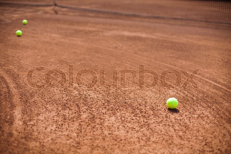 Tennis racket with tennis ball, stock photo