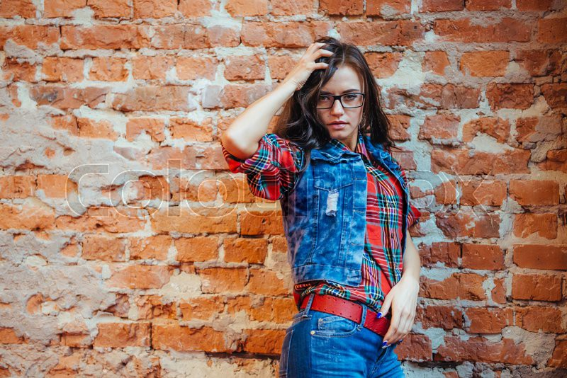 Surprised girl in jeans clothes and a red shirt in the box.Art processing and retouching photos special, stock photo