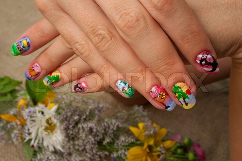 Drawing on nails of unusual figures gives to the woman originality, stock photo