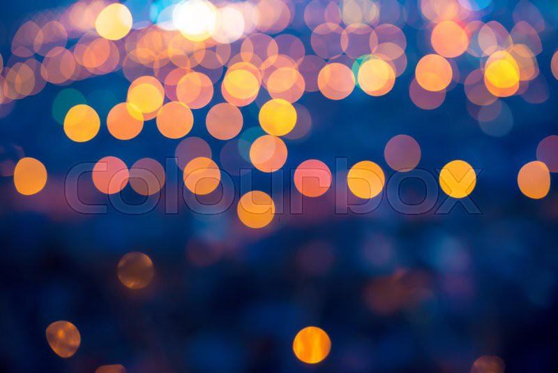 merry christmas lights abstract circular bokeh on blue background closeup stock photo colourbox