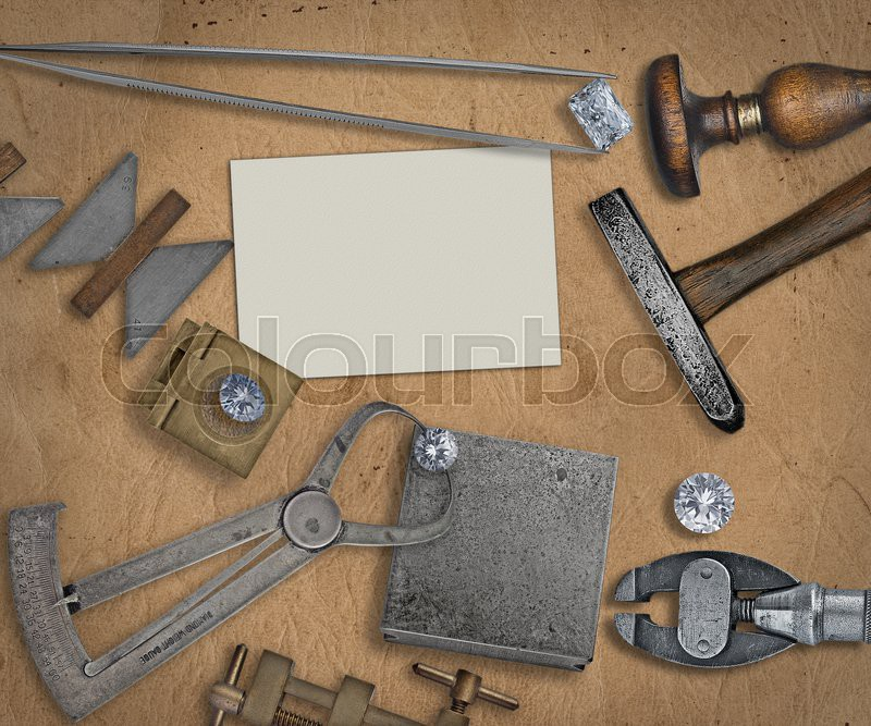 Vintage jeweler tools and diamonds over working bench, blank ...