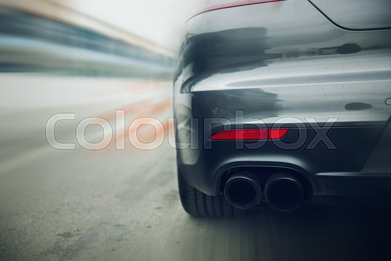 Transportation, speed, racing and road concept - close up of car riding on highway from back, stock photo