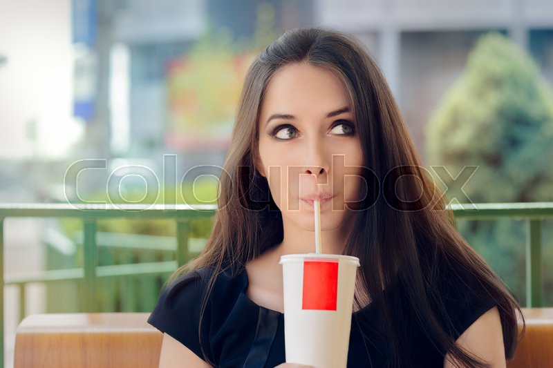 Young Woman Having a Summer Refreshing Drink Outside, stock photo
