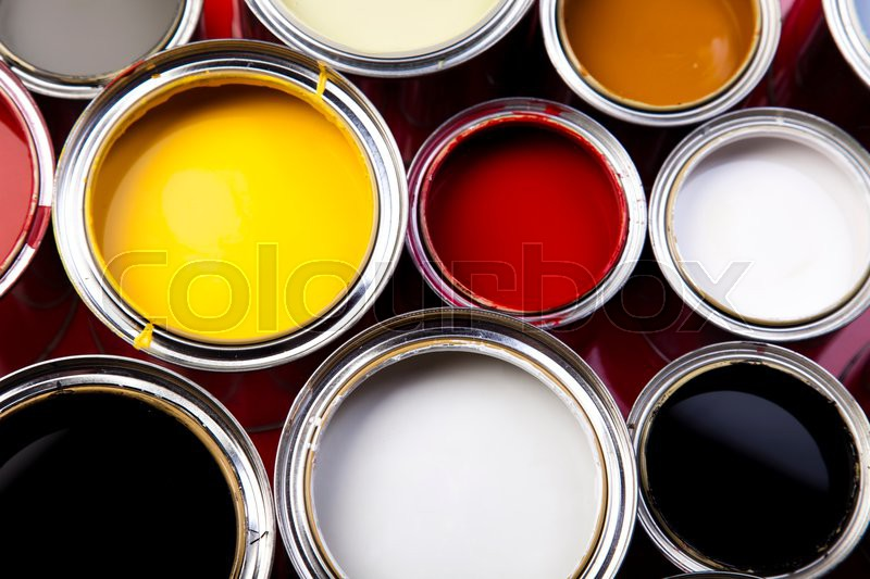 Cans and paint on the colorful background, stock photo