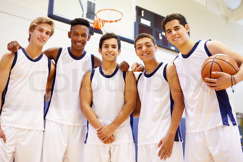 Members Of Male High School Basketball Team, stock photo