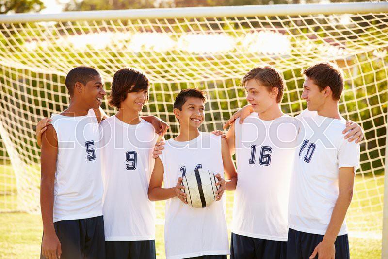 Members Of Male High School Soccer Team, stock photo