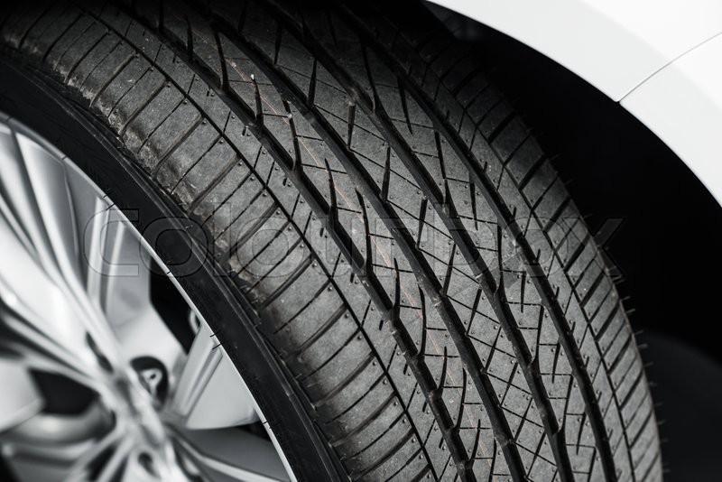 Brand New Car Tire Closeup Photo. Modern Car Tire, stock photo