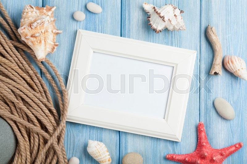Summer time sea vacation with blank photo frame, star fish and marine rope, stock photo