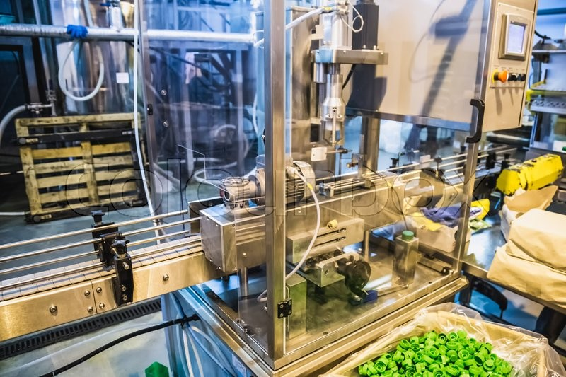 Automatic packing line of conveyor. Pharmaceutical and chemical industry. Manufacture on factory, stock photo