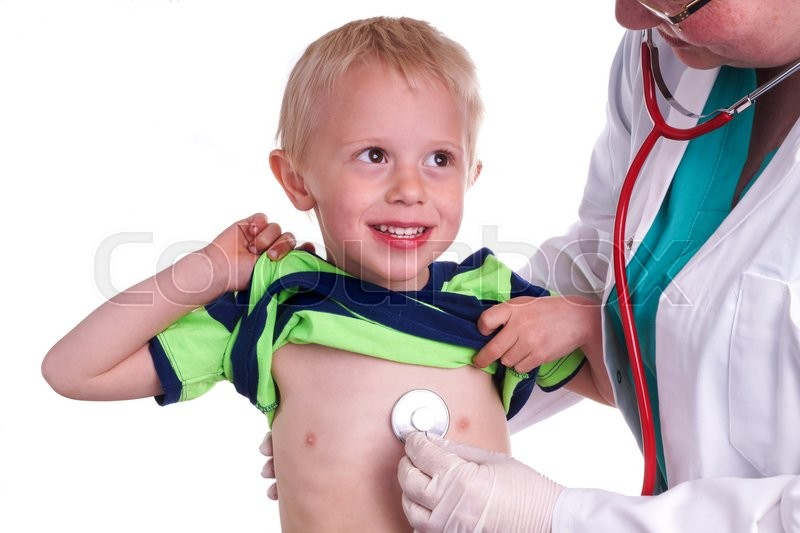 Doctor examines a young child. The doctor examines the child and listening to the heart and lungs with her stethoscope. He helps doctor by lift his shirt up so the nurse can come to listen to the boy\'s chest, stock photo