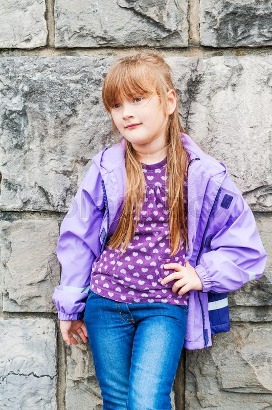 Outdoor Portrait Of A Beautiful Preschool Girl Wearing