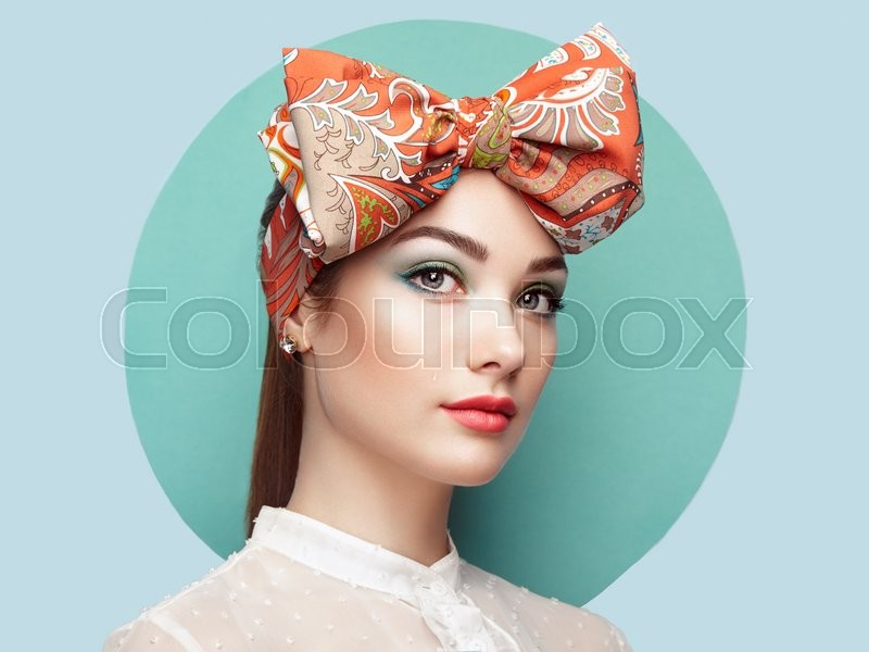 Portrait of beautiful young woman with bow. Brunette girl. Beauty fashion. Cosmetic make-up, stock photo