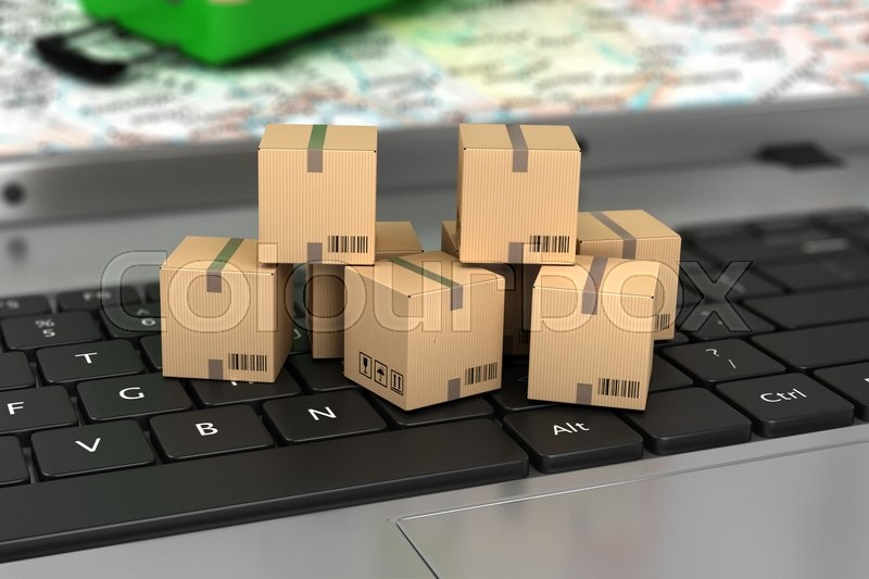 Shipping, delivery and logistics technology business industrial concept: macro view of heap of stacked corrugated cardboard package boxes on computer PC laptop notebook keyboard with selective focus, stock photo