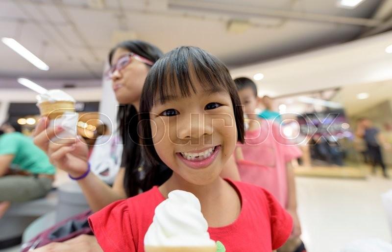Asia Girl Eating Ice-Cream, stock photo