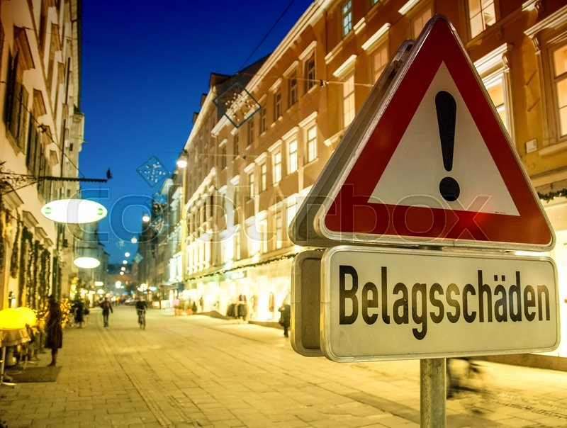 Editorial image of 'Alert street sign in Germany at night.'