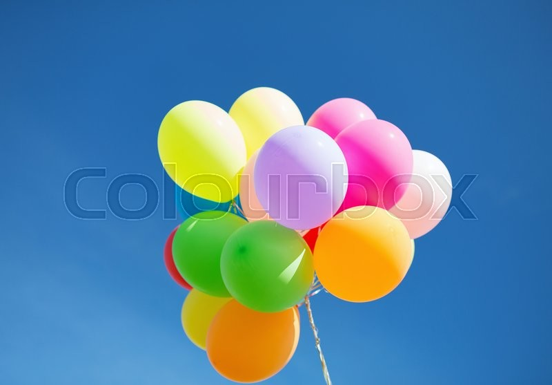 Balloons and celebration concept - lots of colorful balloons in the sky, stock photo