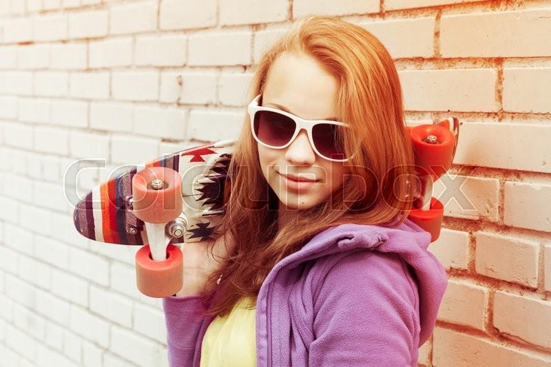 blond holding sunglasses teen Of