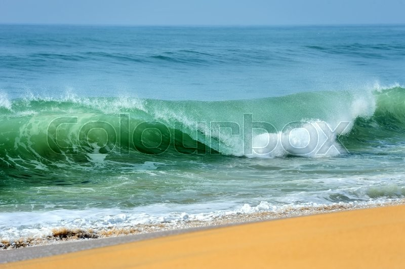 Wave of the ocean on the sand beach, stock photo