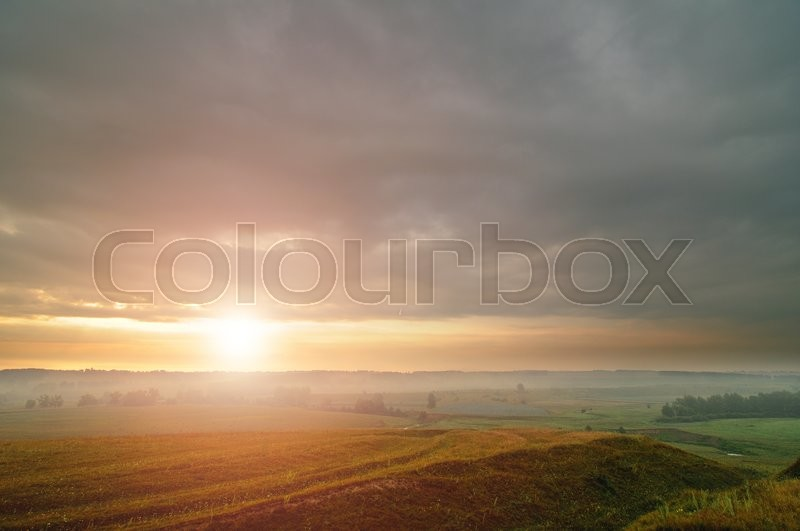 The landscape, the sun rises in the fog, stock photo