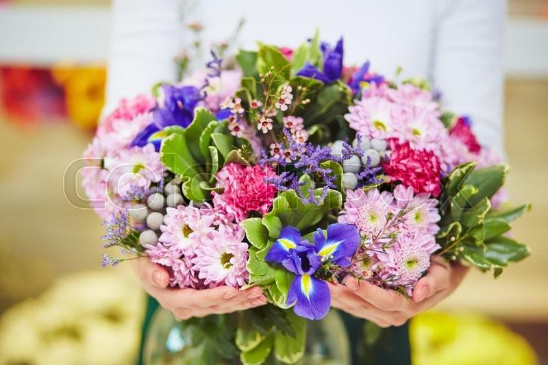 Florist hands with big floral bouquet, stock photo