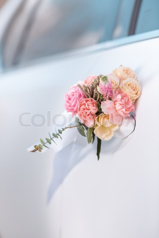 Wedding Car With Beautiful Decorations Of Pink And Orange Roses