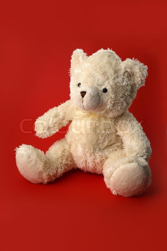 Stock image of 'White teddy bear on red'