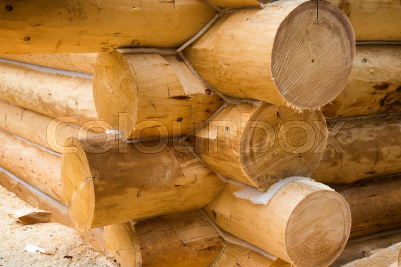 Wall under construction of country wooden house. Details of the loghouse, stock photo