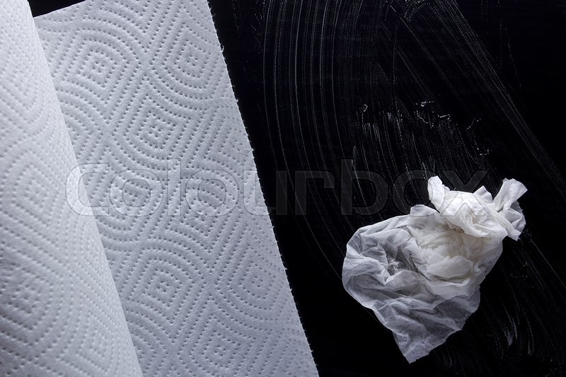 Roll of paper towels and a piece of wet towels and soap, stock photo
