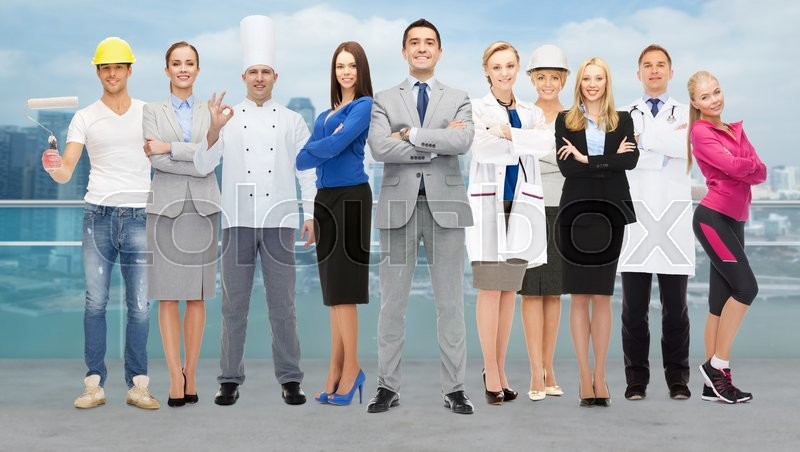 People, profession, qualification, employment and success concept - happy businessman with group of professional workers over city background, stock photo