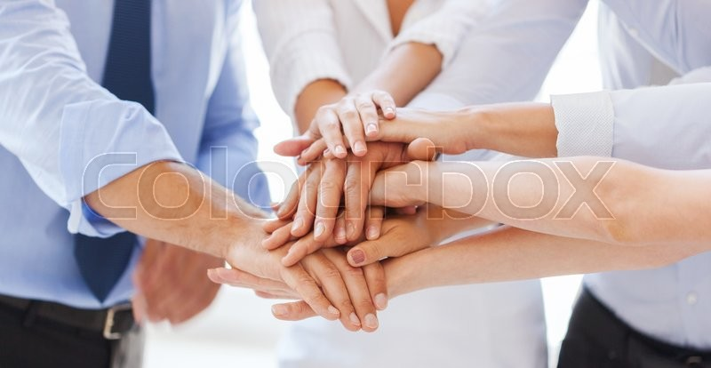 Success and winning concept - happy business team celebrating victory in office, stock photo
