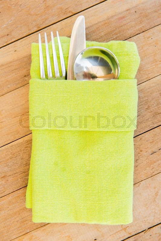 Table setting silverware and eating concept - close up of cutlery set wrapped to napkin on restaurant table | Stock Photo | Colourbox & Table setting silverware and eating concept - close up of cutlery ...