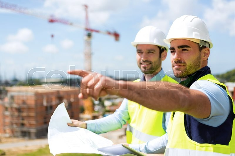 View of a Worker and architect watching some details on a construction, stock photo